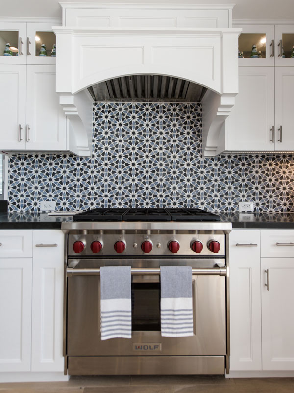 Cement tile backsplash and highend stove