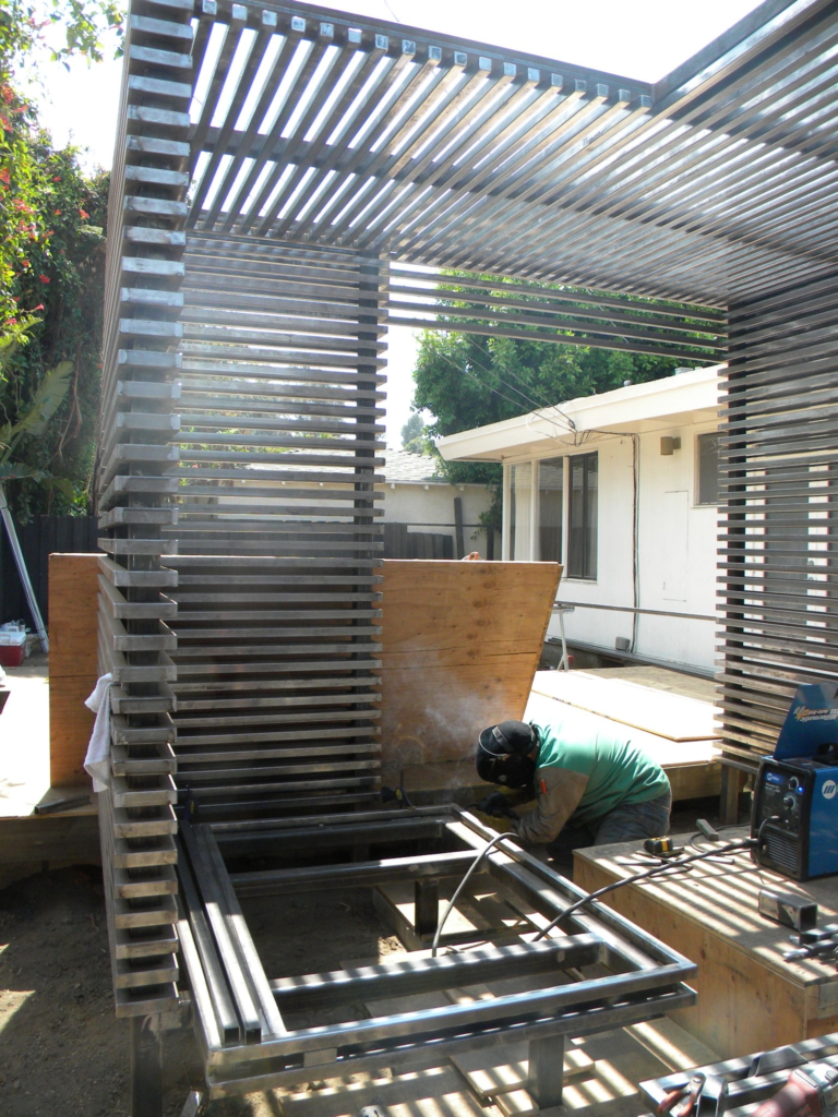 Construction of steel enclosure for outdoor seating area and firepit