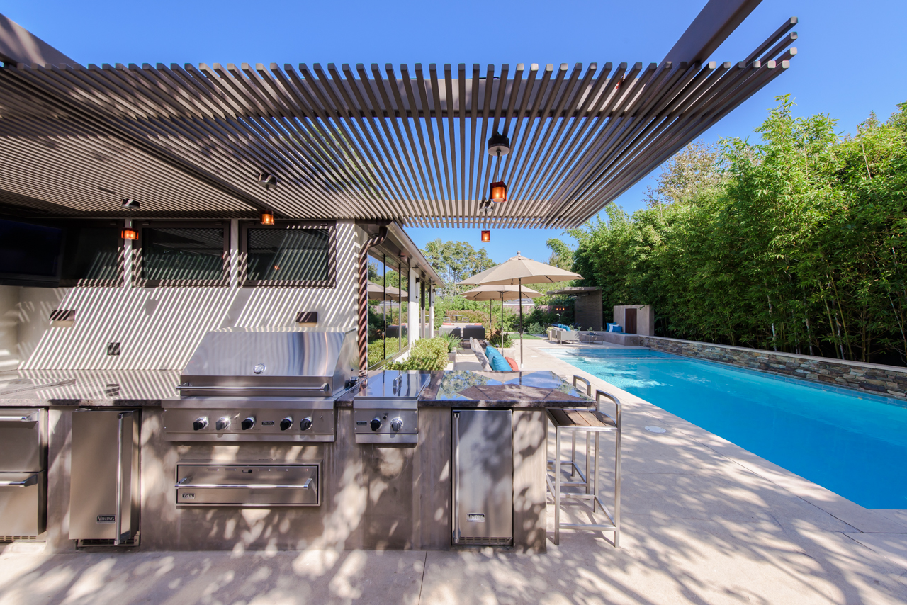 Steel trellis over outdoor kitchen and bbq area